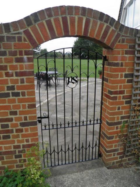 garden gate with initials